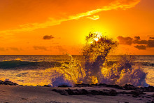 Sunrise Through Crashing Waves