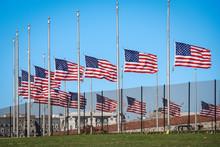USA Flags On A Half Staff.  Honoring Victims. Washington Monument