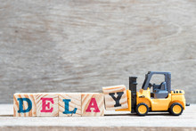 Toy Forklift Hold Letter Block Y To Complete Word Delay On Wood Background