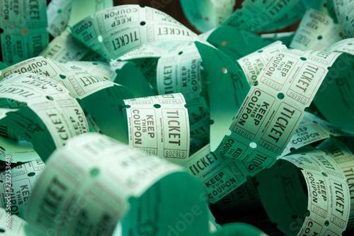 Fotografía Unrolled roll of green admit one raffle tickets