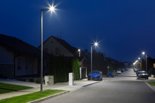 Small City Street With Modern LED Streetlights At Night