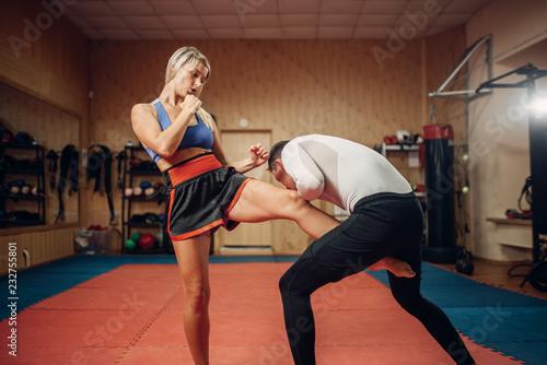 Female person makes kick in groin, self defense