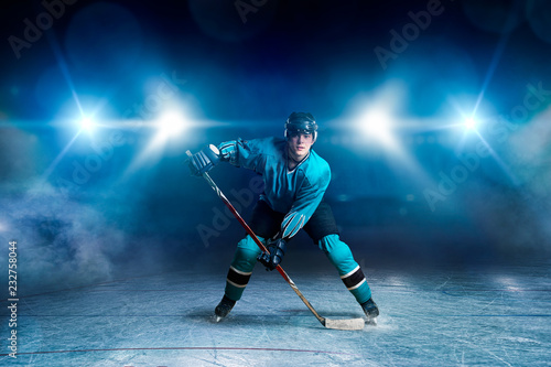 Hockey player with stick on ice, game concept