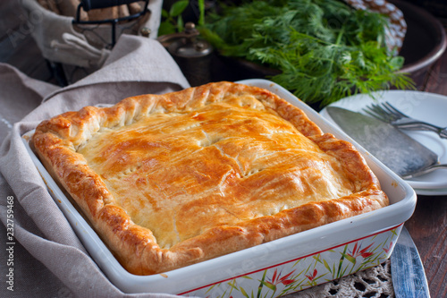 Chicken, potato and onion puff pastry cake, selective focus