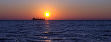Cargo Ship At Sunset In The Black Sea