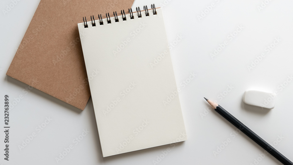 Fototapeta open blank spiral notebook with pencil and eraser on white background.Empty Space for your text.