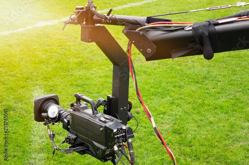 Fotografia  Event video camera on crane live football mach or concert.