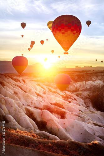 aerostat and sunset in the mountains of Cappadocia. Turkey