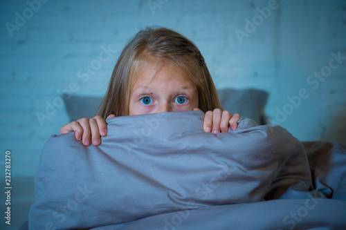 Canvas Sleepless cute girl in fear at night hiding behind the blanket afraid of dark an