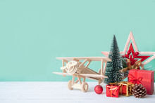 Christmas Gifts, Ornaments And Decorations Collection On White Wooden Table With Green Background And Copy Space