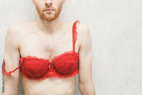 Fotografía  Young man in a red women's bra. Gay