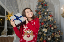 Christmas. Kid Enjoy The Holiday. The Morning Before Xmas. New Year Holiday. Happy New Year. Little Child Girl Likes Xmas Present. Small Happy Girl At Christmas. Christmas Composition