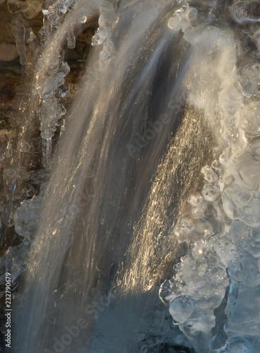 Waterfall running over ice Wall mural