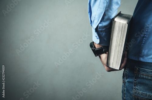 Caucasian man holding bible.