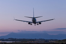 The Plane Lands In The Evening To The Runway Of The Airport Ioannis Kapodistrias Of Greek Island Corfu