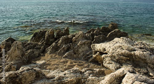 sea shore nature summer landscape with stones rocks waterfront district and big waves