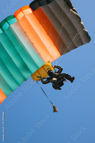 Parachute landing. Skydiver with a bright parachute closeup.