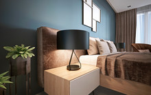 Bedside Night Table With A Lamp In The Modern Bedroom.