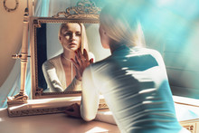 Elegant Blonde Looking At Her Mirror Reflection