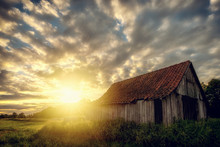 On An Acre Stands An Old Woodshed. Here During A Sunset: Concept: Landscapes Or Sunset