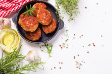 Homemade Cutlets And Herb And Spices  On  Frying Pan On Light Textured Background.