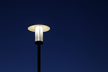 Glowing Street Lamp Isolated On Clear Night Sky Background. Electric Lighting, Lantern Shines