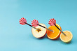 canvas print picture - Orange apple lemon fruit with circular target marked and dart on pastel blue background. minimal idea food and fruit concept. An idea creative to produce work within an advertising marketing communic
