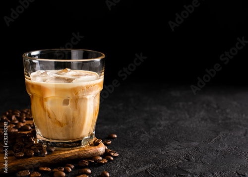 glass cold brew coffee with ice and milk on black or dark background Fototapete