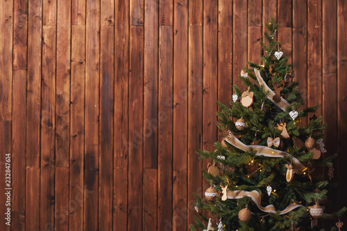 Rustic Christmas tree on a wooden