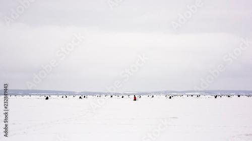 fishermen catch fish on a frozen lake on winter fishing