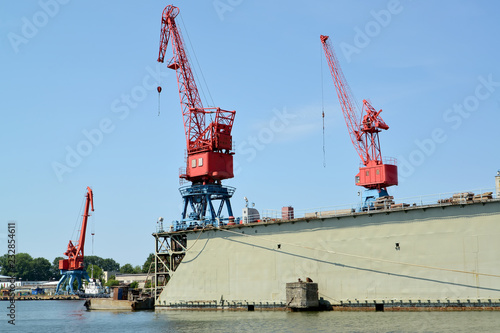 Keuken foto achterwand Poort Port cranes and ship dock in port. City Svetlyj, Kaliningrad region