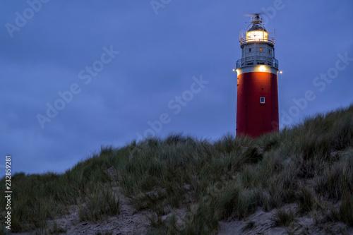 Montage in der Fensternische Leuchtturm Eierland Lighthouse on the northernmost tip of the Dutch island of Texel after dusk