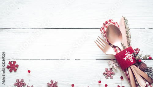 Christmas dinner cutlery on a white wooden background