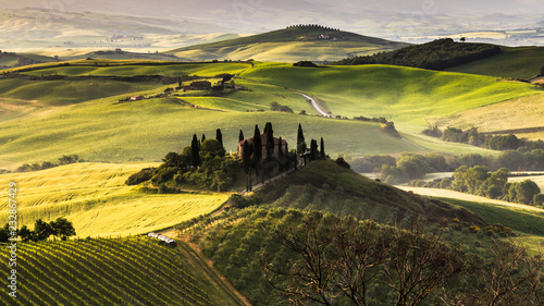 Tuscany Toscana landscape with traditional farm house, hills and meadow. Val d'orcia, Italy.
