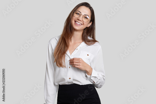 Smiling Young Lady Has Toothy Smile Pleasant Appearance Wears