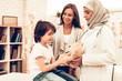 Arabic Doctor Giving Toy to Little Cute Patient