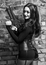 A Woman With A Gun On A Hallow...