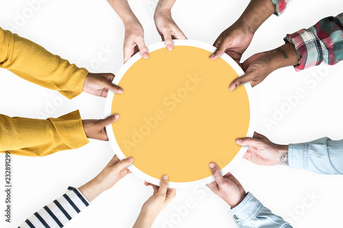 Fototapeta  Diverse hands supporting a blank yellow round board