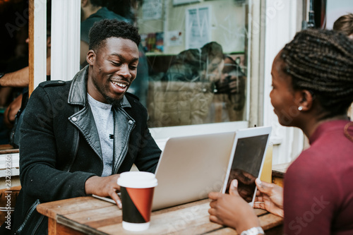 Entrepreneurs working remotely at a cafe