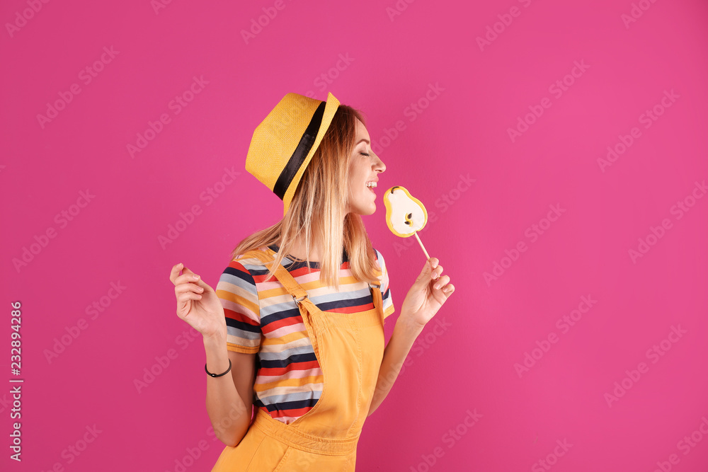 Fototapety, obrazy: Young pretty woman with candy on colorful background