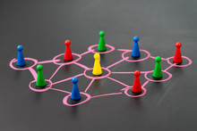 Social Network, Connect Or Relation Concept, Game Plastic Figure On Colorful Pastel Chalk Line Link And Connect Between Multiple Circles Or Tiers On Dark Blackboard