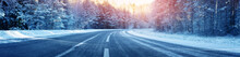 Winter Road, Covered With Snow On Sunny Day. Black Icy Asphalt