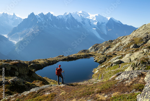 Hiker looking at Lac des Cheserys on the famour Tour du Mont Blanc near Chamonix, France Fototapeta