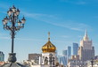 The diverse architecture of Moscow - houses, bell tower, skyscrapers, lanterns.