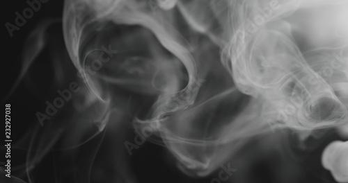 Fotografía  closeup vapor floating in air on black background