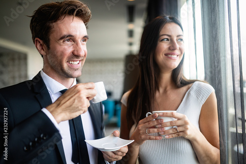 Young couple of professionals chatting during a coffee break