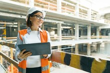 Portrait Of Mature Architect Woman At A Construction Site. Building, Development, Teamwork And People Concept