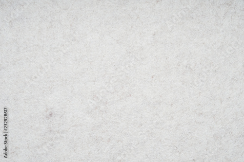 Fotografía  light gray or off-white felt background with fiber texture