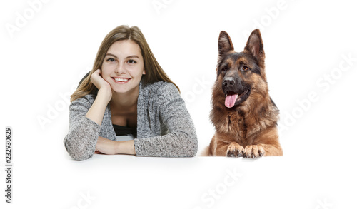 Fototapeta The smiling happy woman and her dog over white background. Shetland Sheepdog sitting in front of a white studio background. The concept of humans and animals same emotions obraz na płótnie