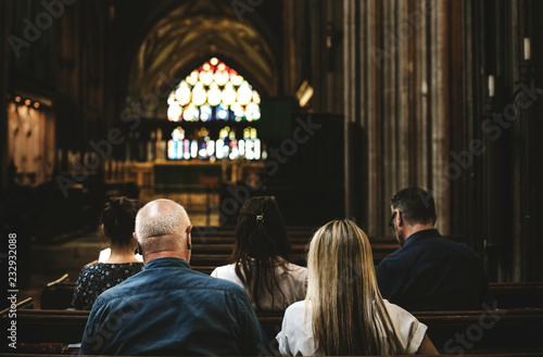 Churchgoers sitting in the pew Fotobehang